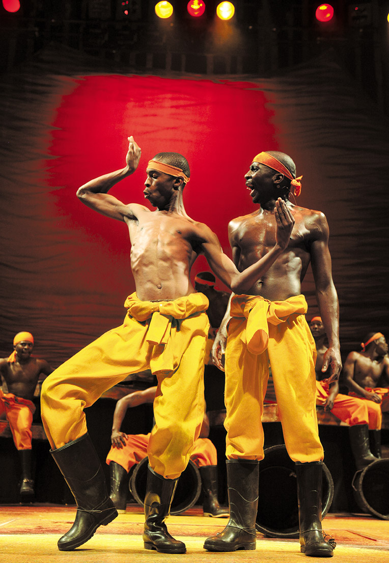 Mosquito in gumboot dancing in Africa Umoja Scene - South African musical