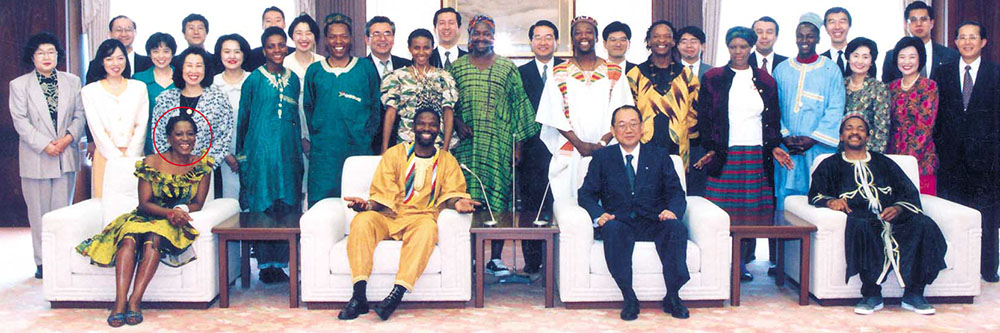 Africa Umoja In Japan, Thembi (front left) enjoys a taste of the Far East.