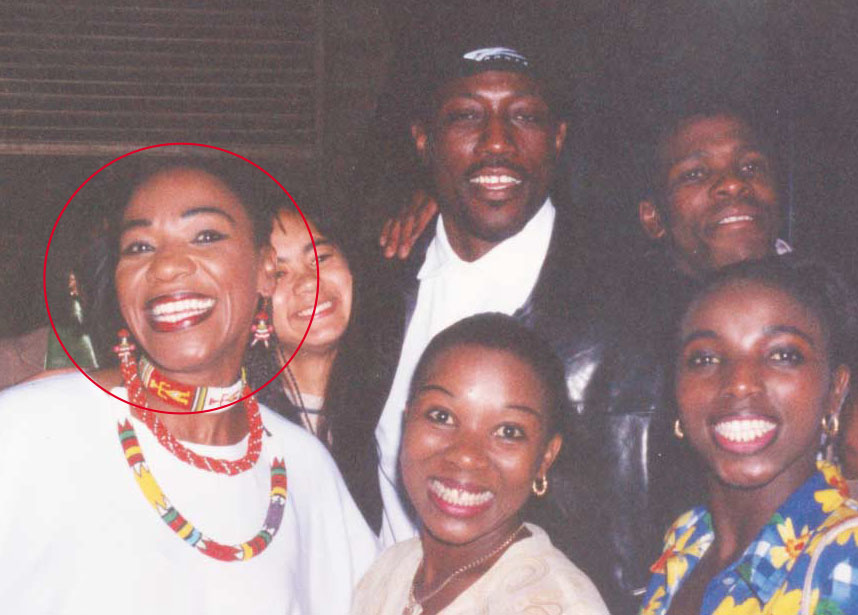 Africa Umoja Todd (front left) standing with Wesley Snipes in the USA.